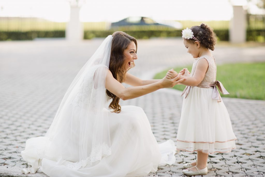 Bride & Flower Girl Before Getting Ready | Travel Inspired Themed Glamorous Gold & White Wedding Luxmore Grande Estate Anna Christine Events Justin DeMutiis Photography