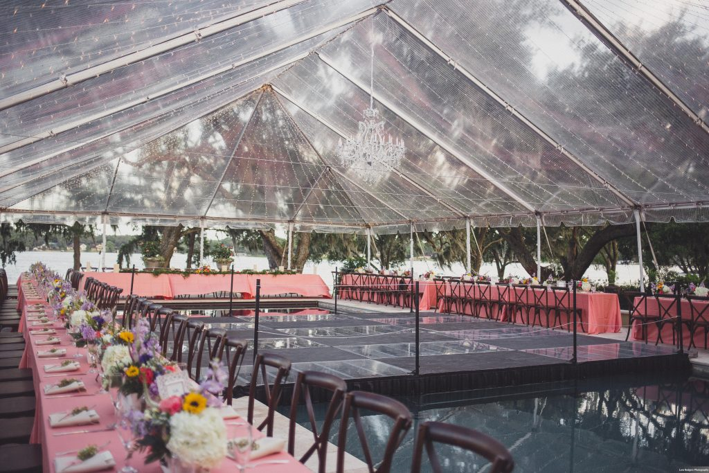Dinner tables around pool dance floor Backyard tent reception | Bright Backyard Wedding Colorful Knowles Chapel Lora Rodgers Photography Anna Christine Events