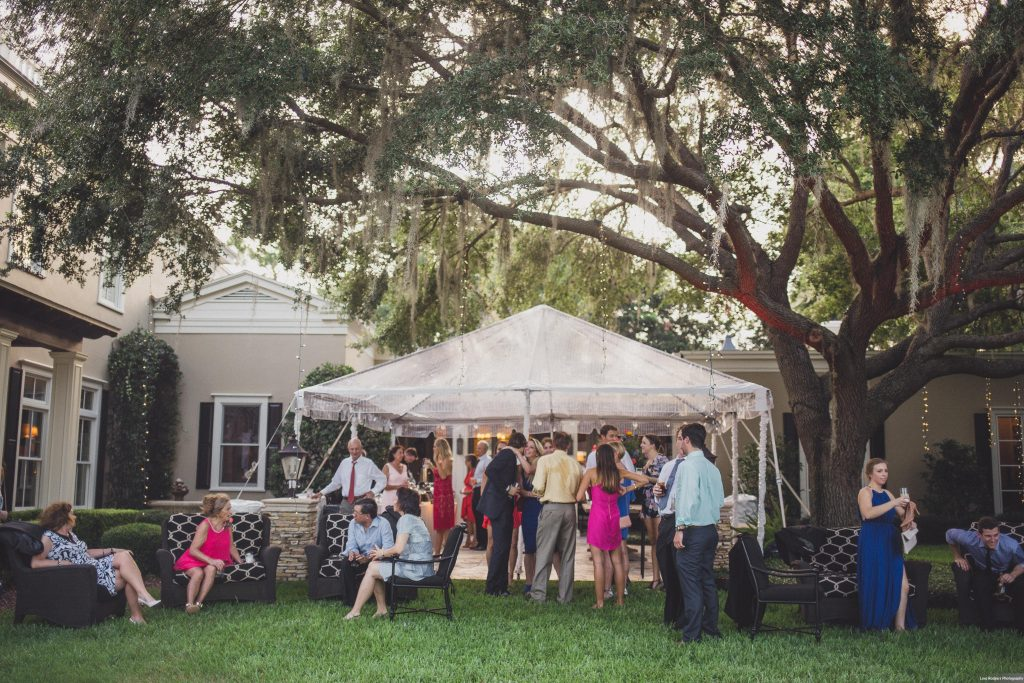 Backyard Cocktail hour guests | Bright Backyard Wedding Colorful Lora Rodgers Photography Anna Christine Events