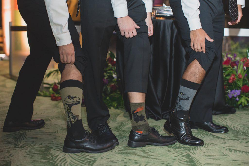 Groom & groomsmen dinosaur socks | Nerd Geek Chic Wedding Theme Game of Thrones Harry Potter Super Mario Orlando Science Center Anna Christine Events Orlando Wedding Planner Ashley Jane Photography