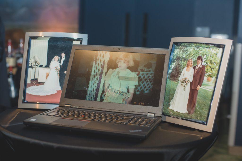 Wedding slideshow on laptop | Nerd Geek Chic Wedding Theme Game of Thrones Harry Potter Super Mario Orlando Science Center Anna Christine Events Orlando Wedding Planner Ashley Jane Photography