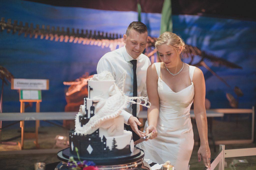 Bride & groom cutting cake Sprinkles Custom Cakes | Nerd Geek Chic Wedding Theme Game of Thrones Harry Potter Super Mario Orlando Science Center Anna Christine Events Orlando Wedding Planner Ashley Jane Photography