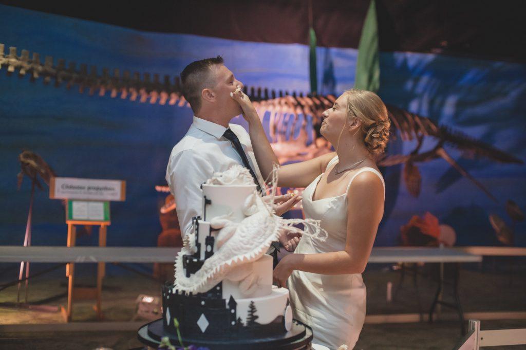 Bride & groom cutting cake | Nerd Geek Chic Wedding Theme Game of Thrones Harry Potter Super Mario Orlando Science Center Anna Christine Events Orlando Wedding Planner Ashley Jane Photography