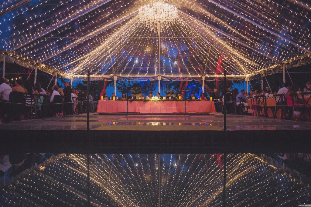 Reflection of tent into pool | Bright Backyard Wedding Colorful Lora Rodgers Photography Anna Christine Events