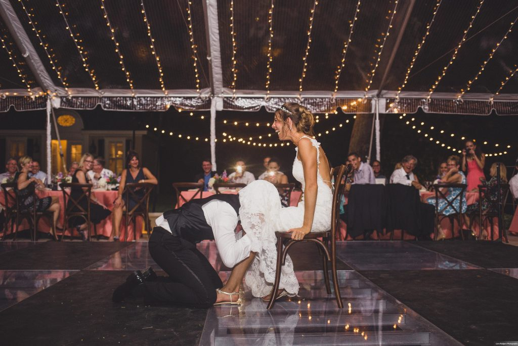 Groom finding garter | Bright Backyard Wedding Colorful Lora Rodgers Photography Anna Christine Events