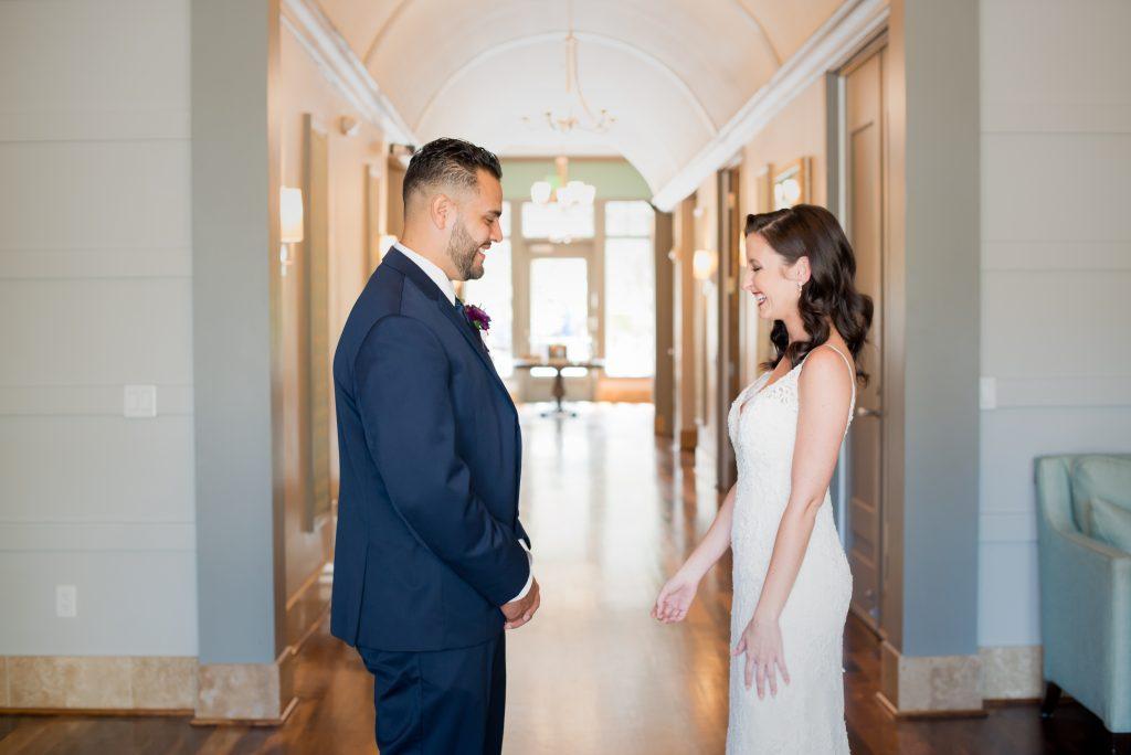 First Look bride & groom | Classic Purple & White Wedding Photography Noah's Event Venue Orlando Florida Anna Christine Events Wedding Planner Jessica Leigh