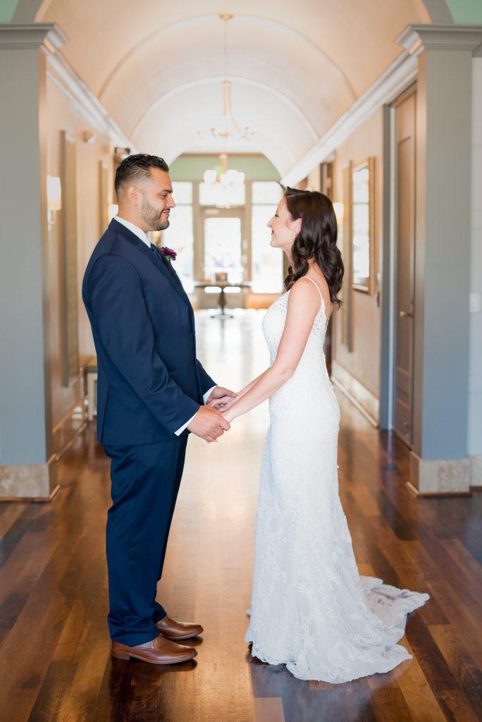 Bride & groom first look | Classic Purple & White Wedding Photography Noah's Event Venue Orlando Florida Anna Christine Events Wedding Planner Jessica Leigh