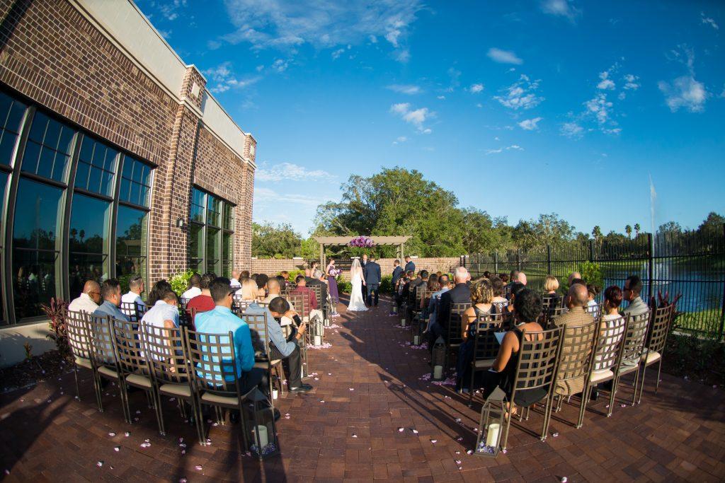 Bride & groom ceremony | Classic Purple & White Wedding Photography Noah's Event Venue Orlando Florida Anna Christine Events Wedding Planner Jessica Leigh
