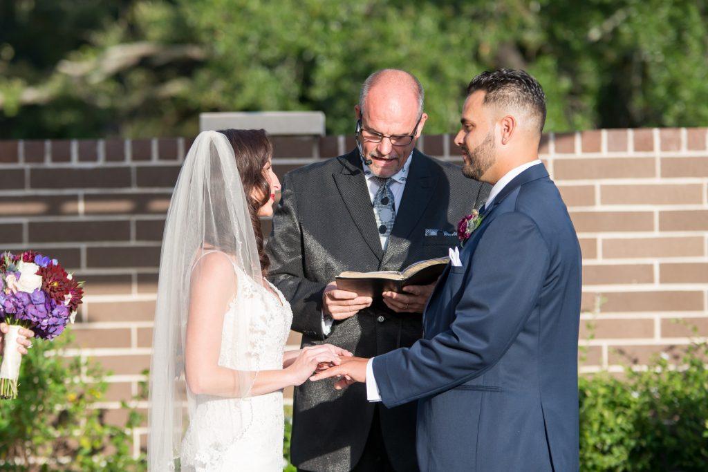 Bride & groom at ceremony | Classic Purple & White Wedding Photography Noah's Event Venue Orlando Florida Anna Christine Events Wedding Planner Jessica Leigh