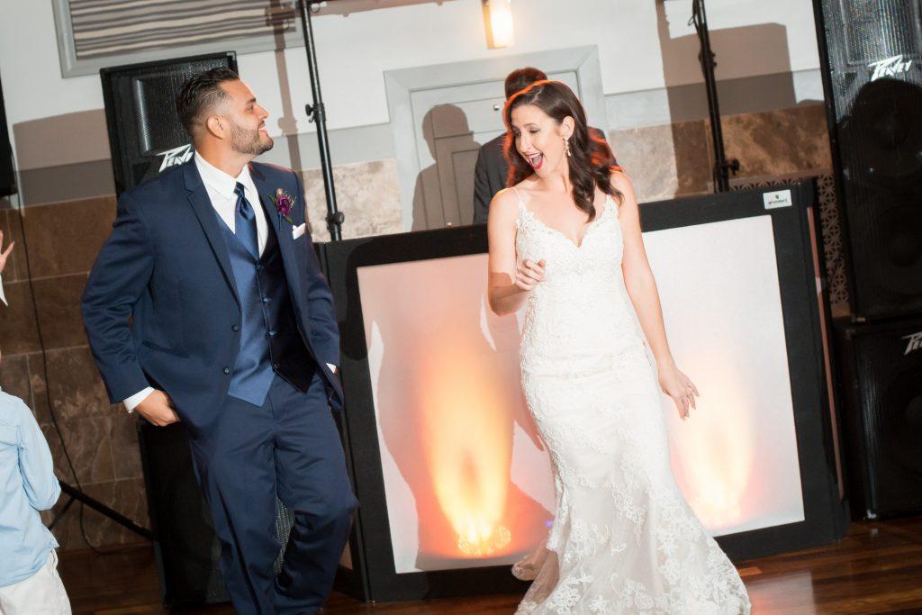 Bride & groom entrance reception | Classic Purple & White Wedding Photography Noah's Event Venue Orlando Florida Anna Christine Events Wedding Planner Jessica Leigh