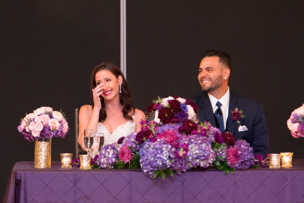 Bride & groom listening to toasts speeches | Classic Purple & White Wedding Photography Noah's Event Venue Orlando Florida Anna Christine Events Wedding Planner Jessica Leigh