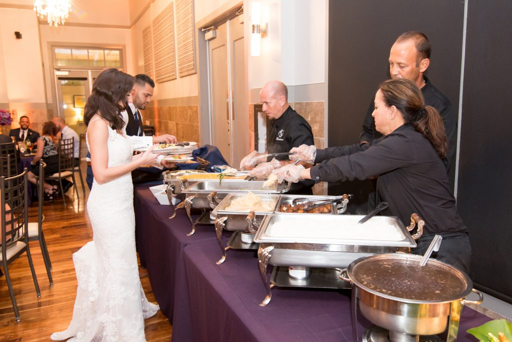 Bride & groom at buffet | Classic Purple & White Wedding Photography Noah's Event Venue Orlando Florida Anna Christine Events Wedding Planner Jessica Leigh