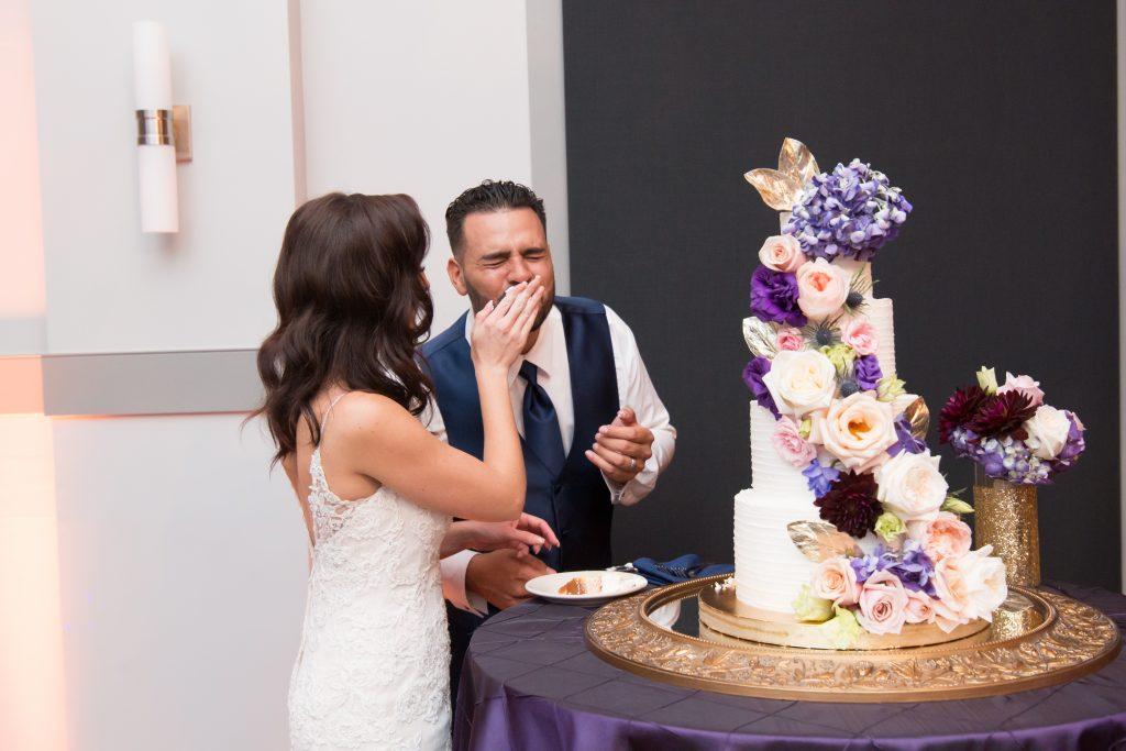 Cutting the cake | Classic Purple & White Wedding Photography Noah's Event Venue Orlando Florida Anna Christine Events Wedding Planner Jessica Leigh