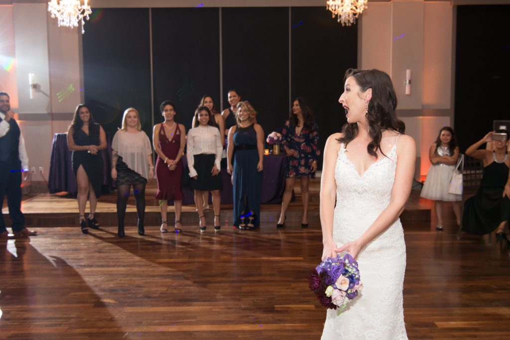 Bride tossing bouquet | Classic Purple & White Wedding Photography Noah's Event Venue Orlando Florida Anna Christine Events Wedding Planner Jessica Leigh