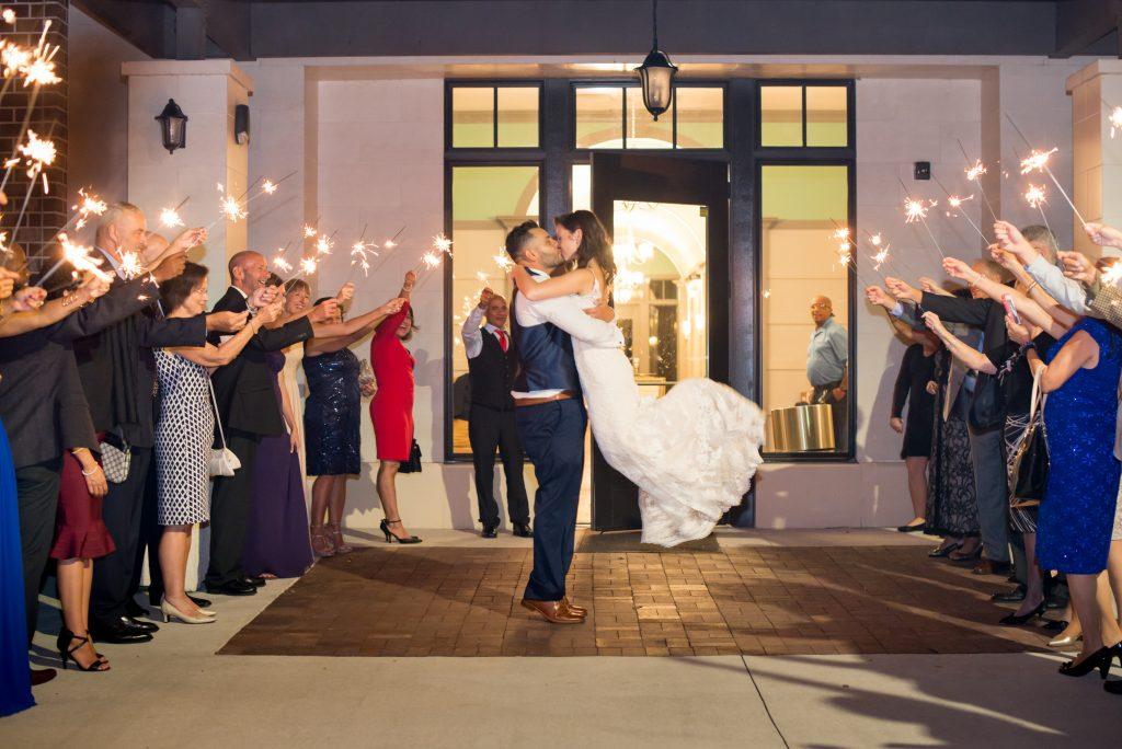 Bride & groom sparkler exit | Classic Purple & White Wedding Photography Noah's Event Venue Orlando Florida Anna Christine Events Wedding Planner Jessica Leigh