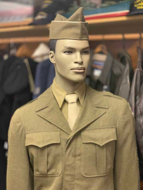 Mannequin dressed with military uniform and hat