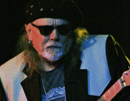 Tas Cru performing live at Arts Garage in March 2021