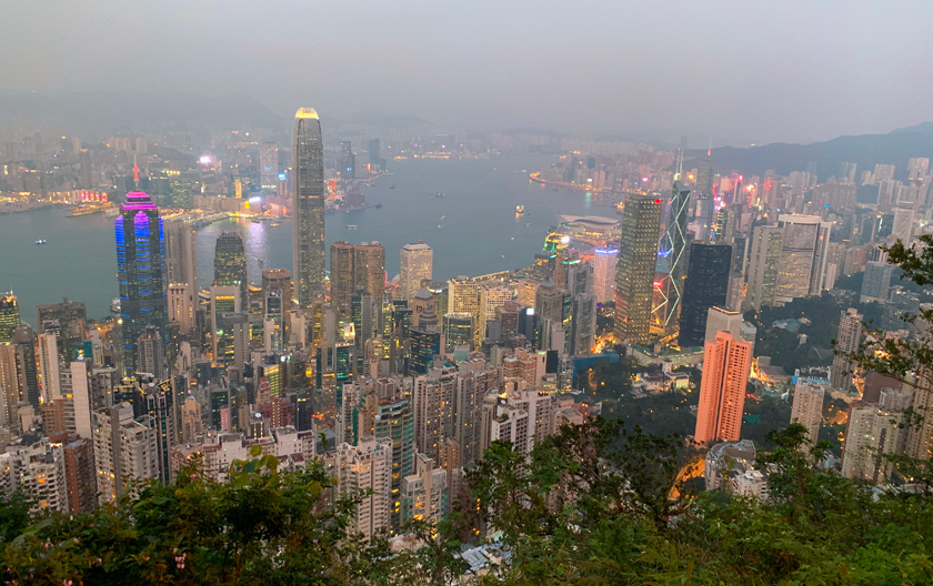 Dusk view from Victoria Peak of Hong Kong skyline and Victoria Harbor