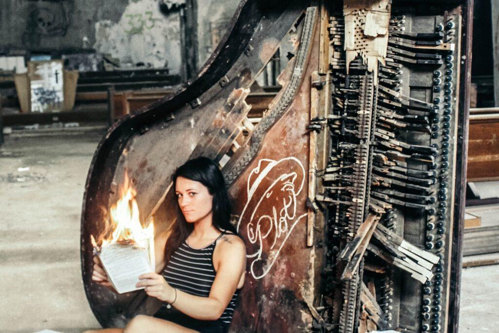 woman with broken piano