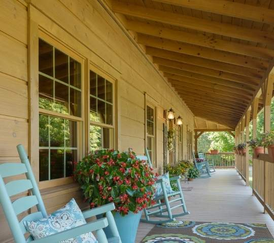 photo of covered porch with rows of rocking chairs.