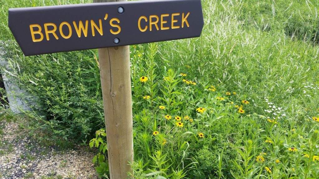 Brown's Creek Sign with Flowers