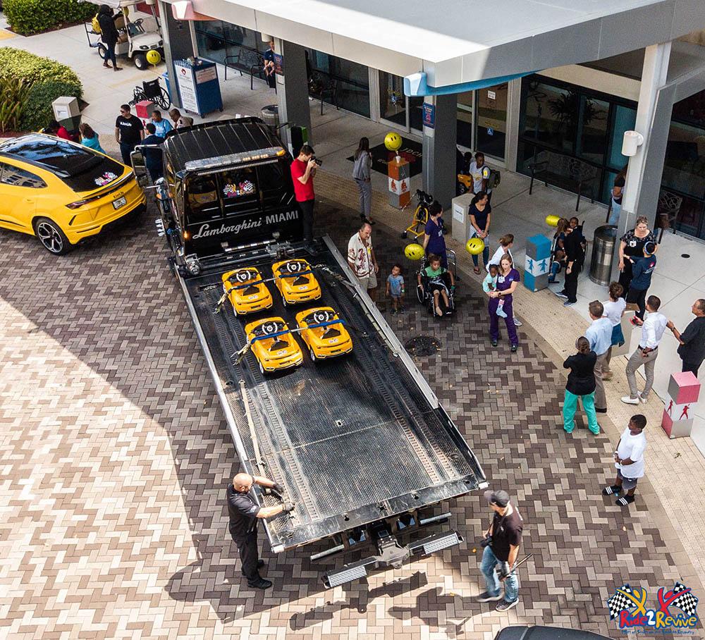Yellow mini Lamborghini Urus cars arrive at Joe DiMaggio's Children's Hospital