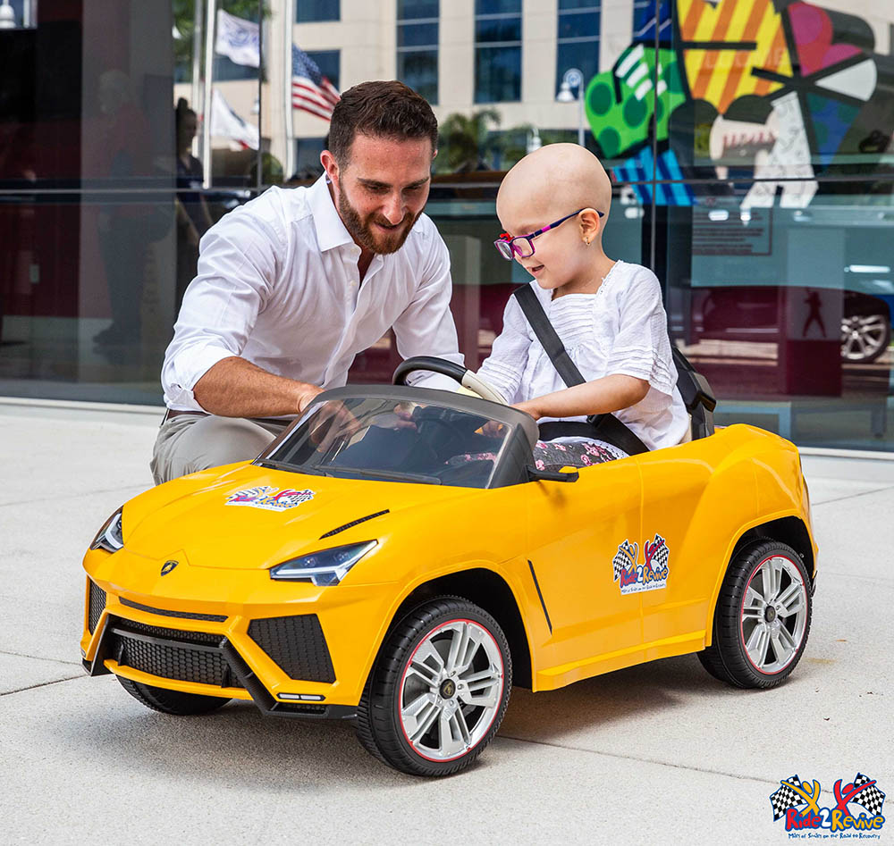 Brett David with one of the kids and the Mini Lamborghini
