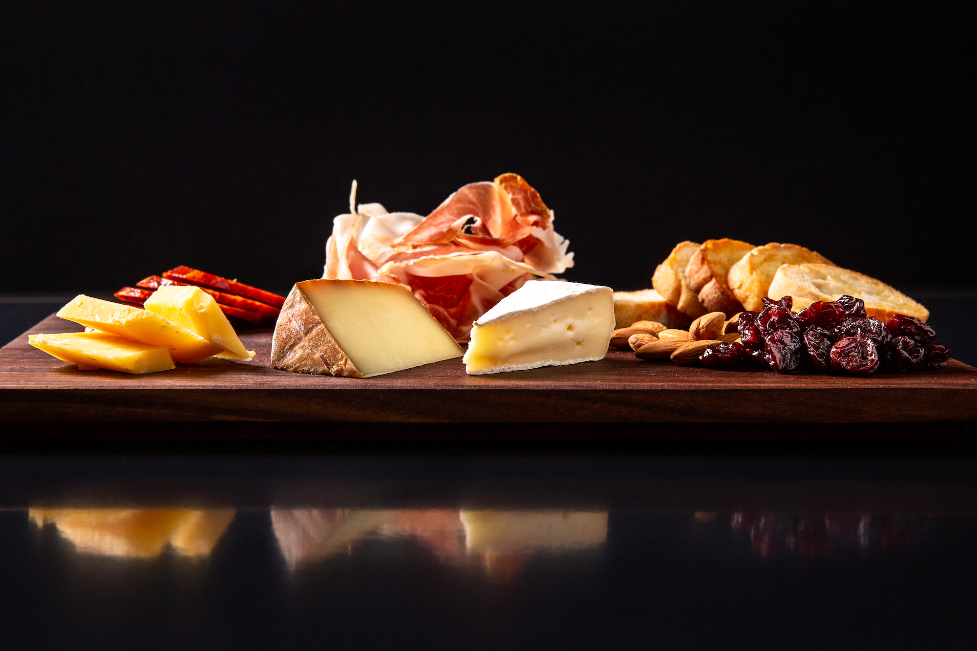 meat and cheese on a cutting board