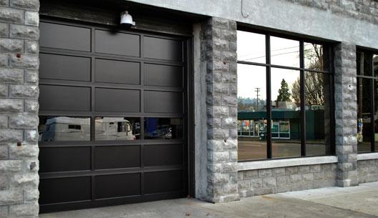 nice custom garage door with glass panel installed by Innovative Garage Door in Chicago area