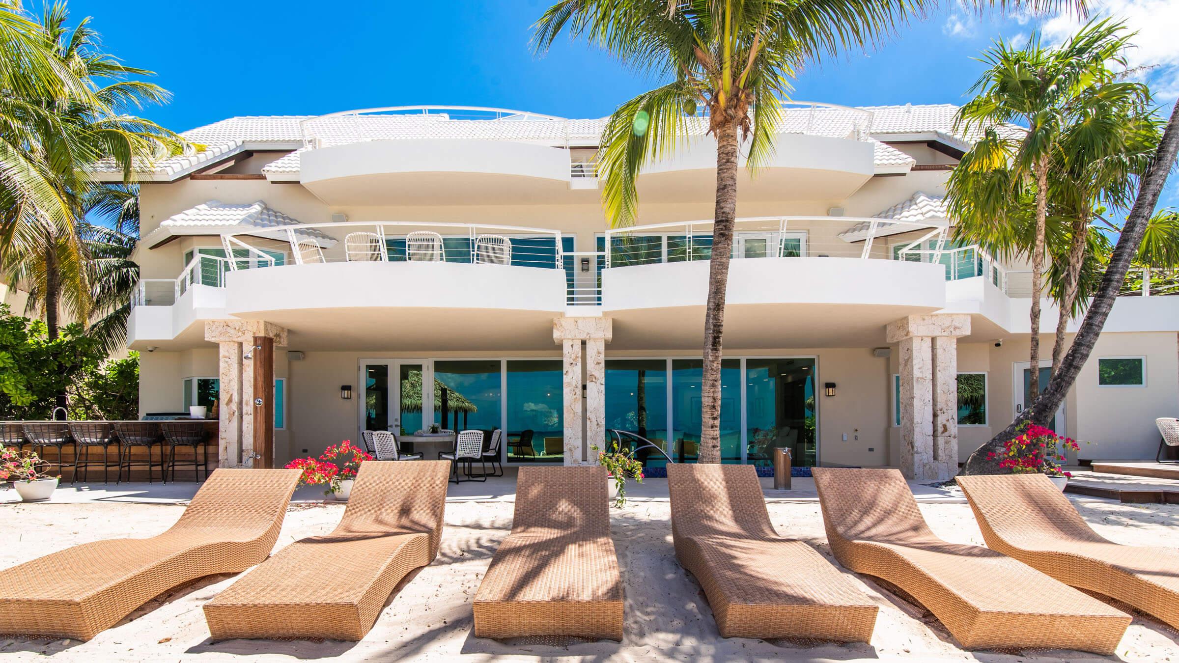 Seascape-Villa-Beach-Villa-Cayman-Islands-Grand-Cayman-Paradise-Beach-View-Sand-Loung-Chairs.jpg
