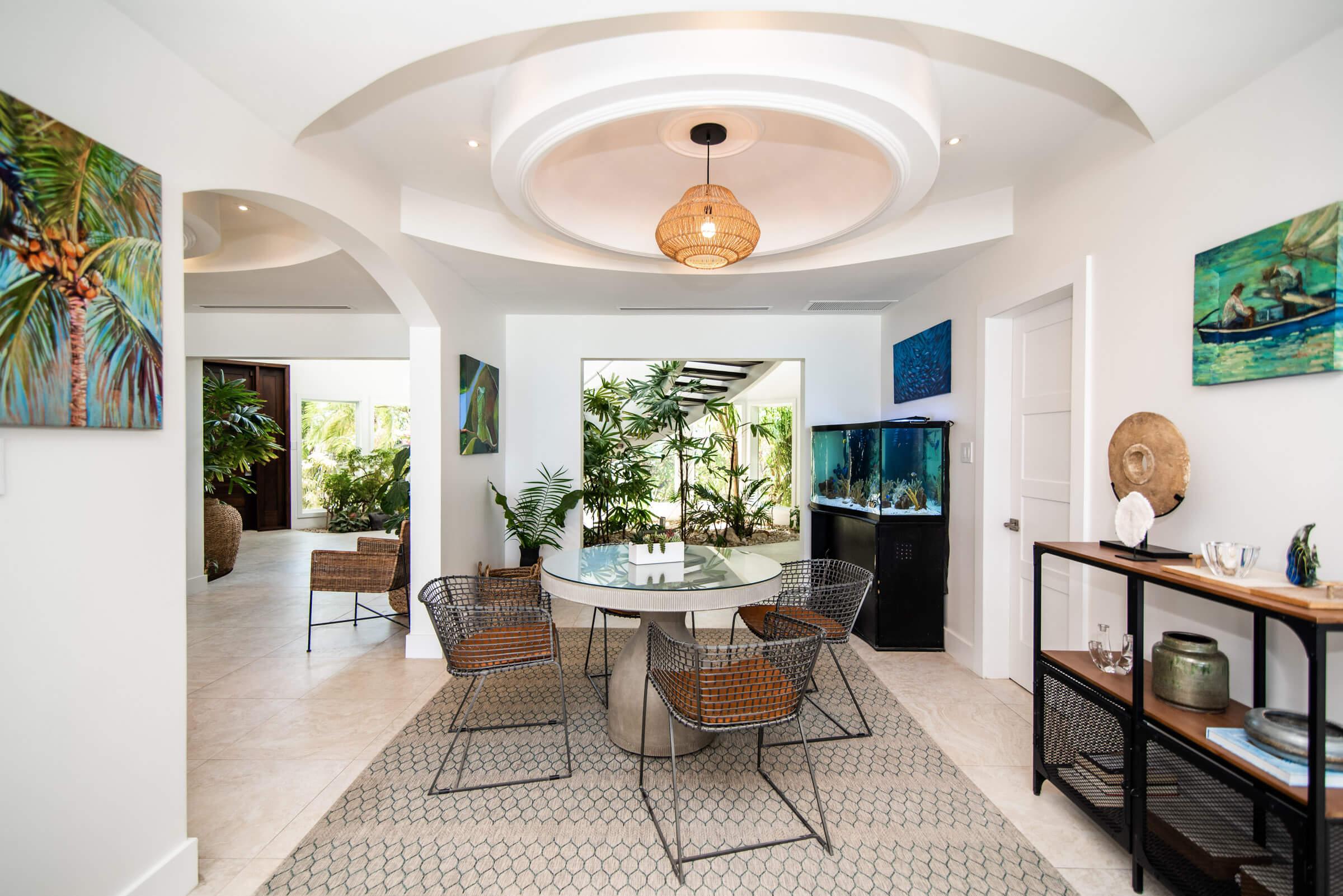 Seascape Villa Cayman Islands Grand Cayman Family Beachfront Luxury Caribbean Vacation Rental Dining Room Family Room Entertainment Area