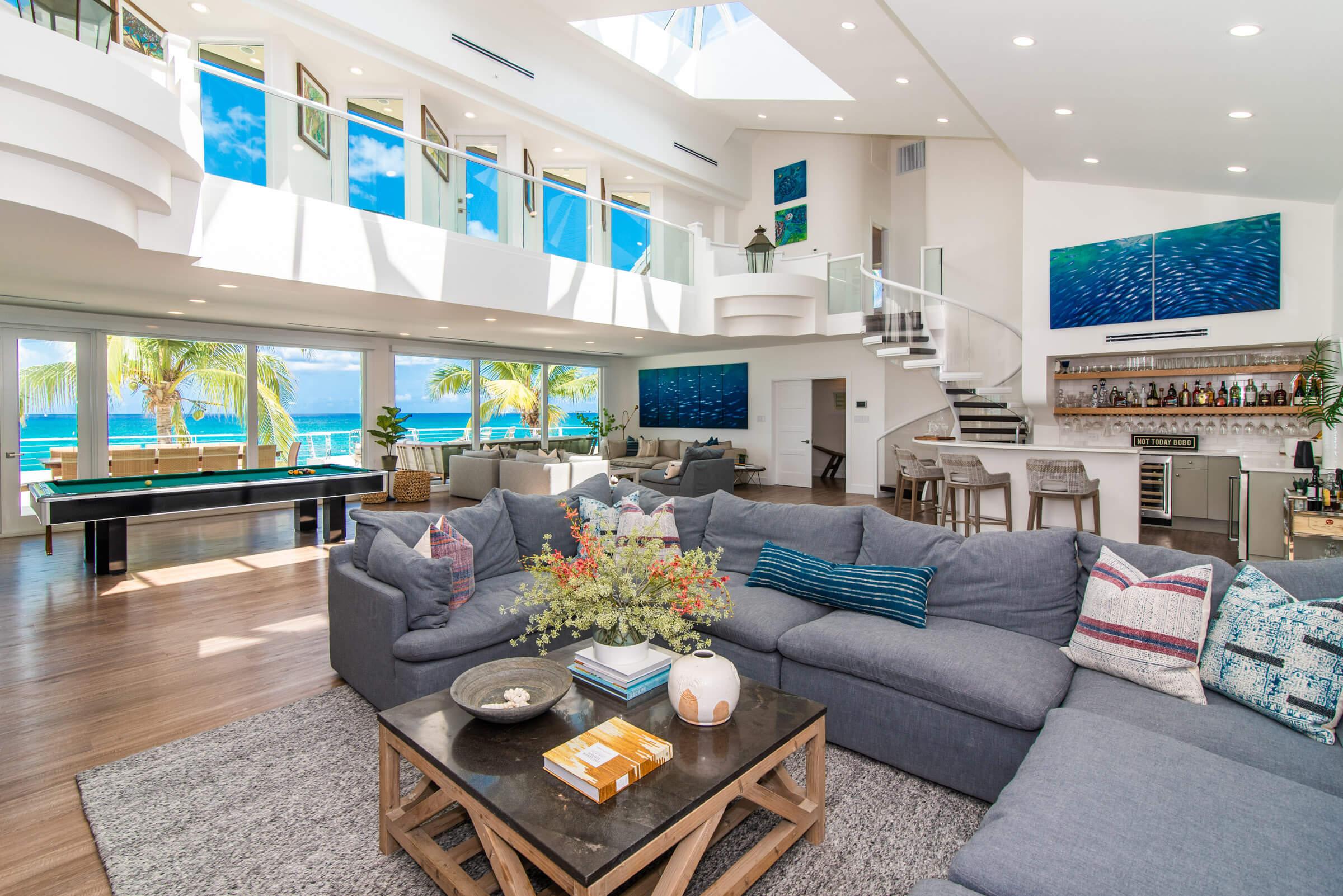 ascape Villa Cayman Islands Grand Cayman Family Beachfront Luxury Caribbean Vacation Rental Dining Room Family Room Entertainment Area