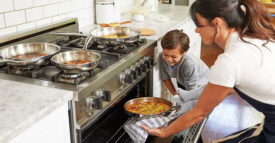 mother-son-putting-food-oven