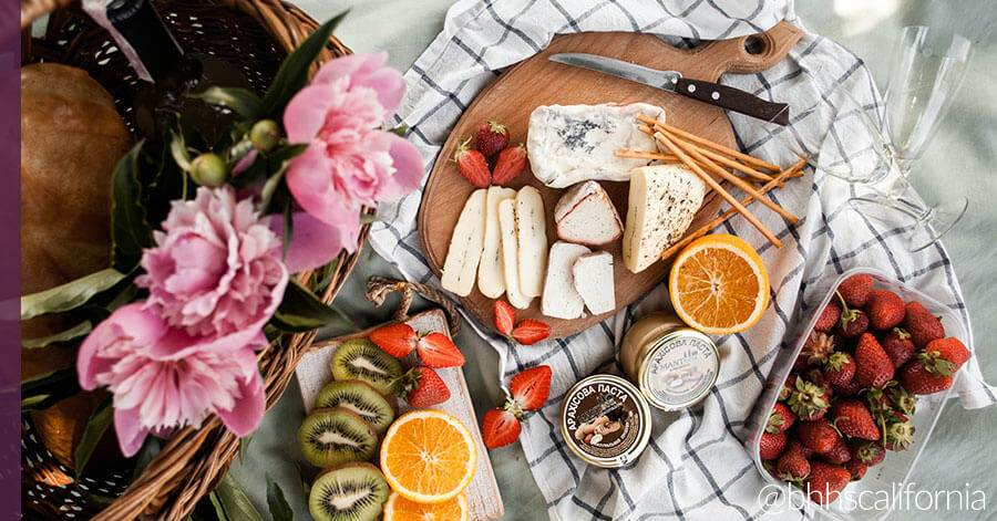 outdoor activities, picnic spread with cheese and fruit
