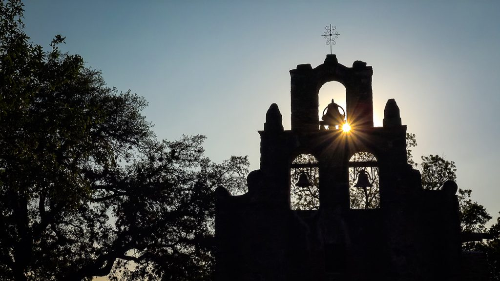 The silhouette of an old stone church