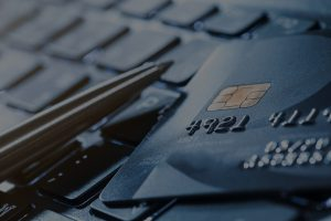 Image of credit card laying on a laptop.