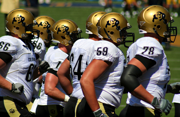 The Buffaloes try to gain some momentum behind the offensive line. Photo Courtesy: John Martinez Pavliga