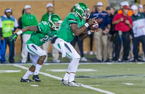 Mean Green QB DaMarcus Smith (10) will rely heavily on RB Jeffrey Wilson (26) to get the offense going against UTEP. Photo Courtesy: Sandy McAnally