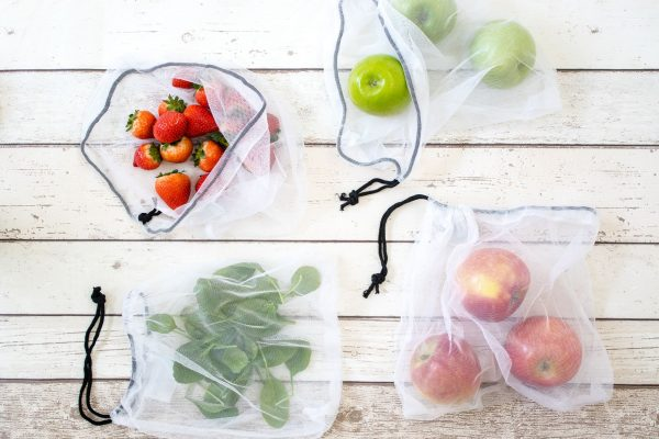 reusable produce bags with fruits and vegetables
