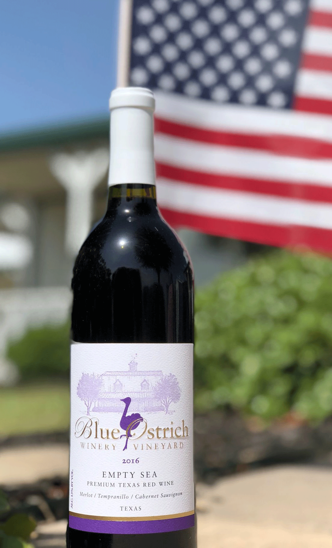 wine bottle outside in front of a USA flag