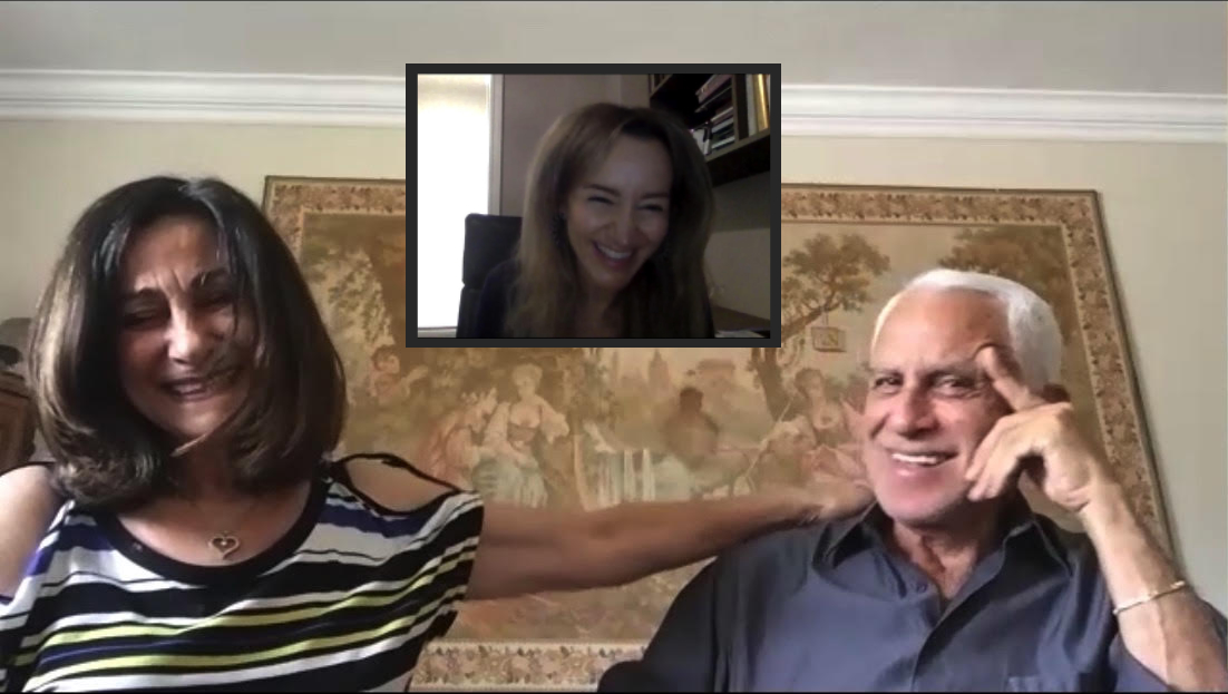 Older couple on couch talkling over video conference with Romy