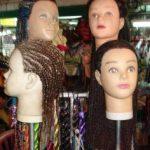 Hair braid vendors make good money on this backpacker street