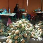 Vendors selling Pineapples...