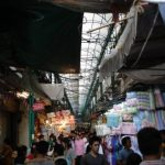 Walking through narrow markets near the Textile shops