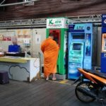 At the port... thought it was neat to see a monk at the ATM