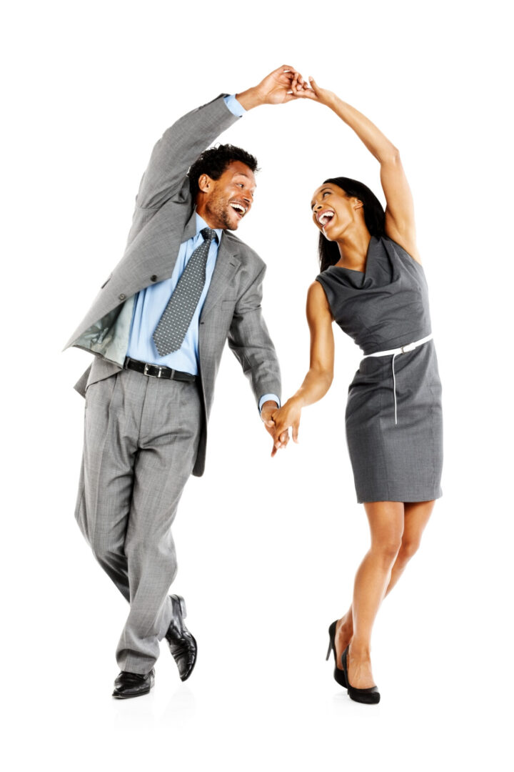 Full length image of happy business couple dancing on white background