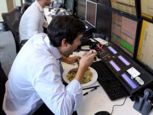 working man eating at desk