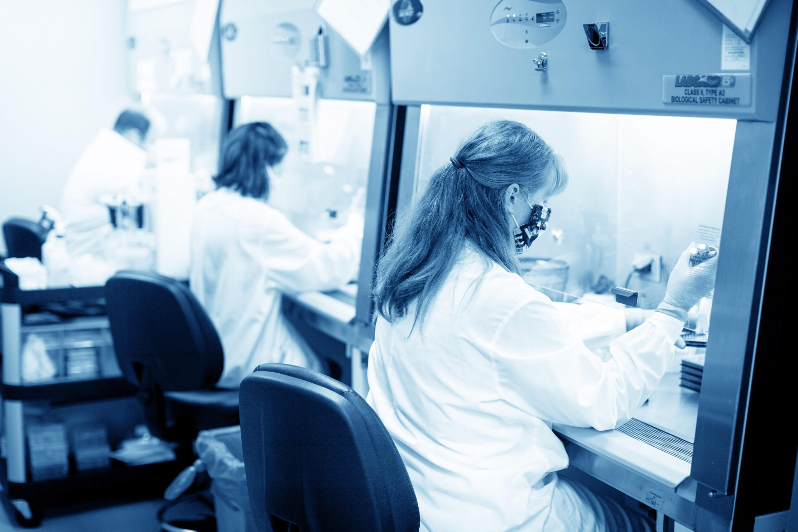lab technicians processing neutralizing antibody test