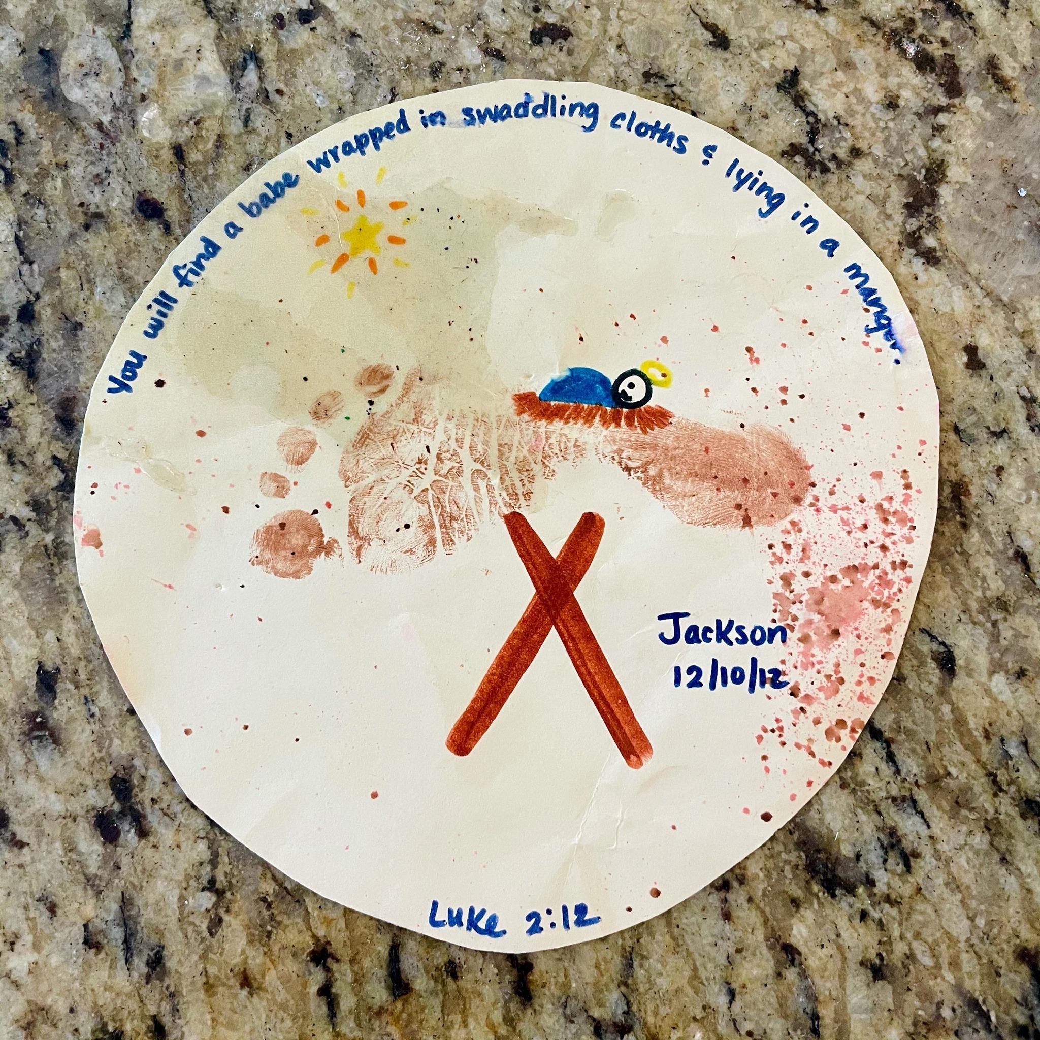 children's craft with baby Jesus in a footprint manger
