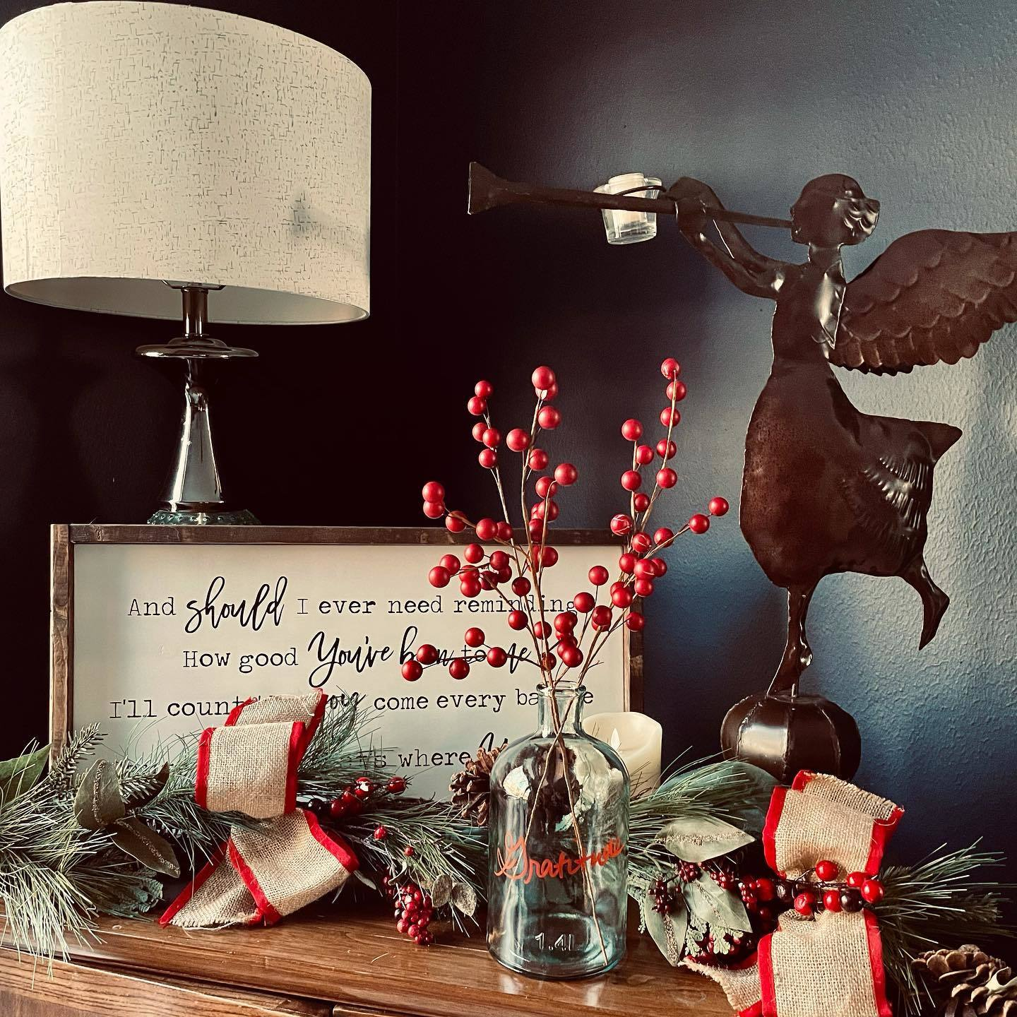"""advent display with garland, angel, and glass jar featuring the word """"Gratitude"""""""